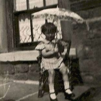 Barbara, two years old with a parasol