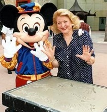 After signing her name next to her hand-prints for Disney's 'Walk of Fame', Barbara Taylor Bradford and Mickey Mouse give a show of hands