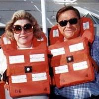 Barbara Taylor Bradford & Bob Bradford in life preservers on a sea cruise