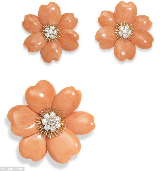 A coral and diamond Rose de Noel brooch and earclip suite. Estimated worth: £13,000-£20,000