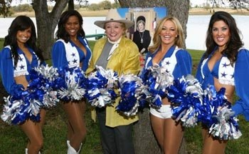 Barbara Taylor Bradford and the Cowboys Cheerleaders strike a pose with pompoms