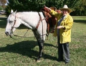 Barbara Taylor Bradford saddles a gray riding horse at the Lupton Ranch in Dallas, Texas