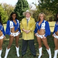 Barbara Taylor Bradford poses with the Dallas Cowboys Cheerleader Squad at the Lupton Ranch in Dallas, Texas