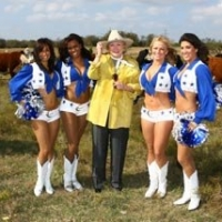 Barbara Taylor Bradford and the Dallas Cowboys Cheerleaders get up-close and personal with the cattle at the Lupton Ranch in Dallas, Texas