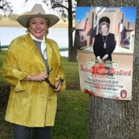 Wanted Dead Or Alive? Barbara Taylor Bradford poses with her Dallas event poster at the Lupton Ranch in Dallas, Texas