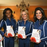 Members of the Dallas Cowboys Cheerleaders proudly display their signed copies of Barbara Taylor Bradford's novel, The Heir