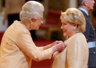 Barbara Taylor Bradford with Her Majesty Queen Elizabeth II