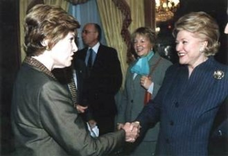 Barbara Taylor Bradford greets First Lady, Laura Bush, guest-of-honor at a luncheon given by the Police Athletic League (PAL), a charity for children. December 2003 in New York City