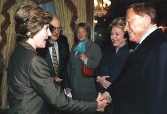 Robert Bradford and Barbara Taylor Bradford greet US First Lady Laura Bush at a New York event for the Police Athletic League, a charity for underprivileged children in New York City