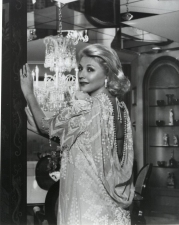 Barbara Taylor Bradford in a backless dress