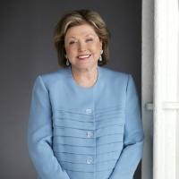 Barbara Taylor Bradford wearing pale blue trouser suit
