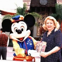 Barbara Taylor Bradford promoting her novel Everything to Gain with Mickey Mouse at Walt Disney World